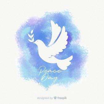 素敵な鳩と水彩画の平和の日の構成 Premiumベクター