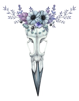 Watercolor raven skull with a flower wreath in blue tones