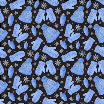 ミトン、帽子、コーン、雪片の水彩画のシームレスなパターン。青いニットの冬服