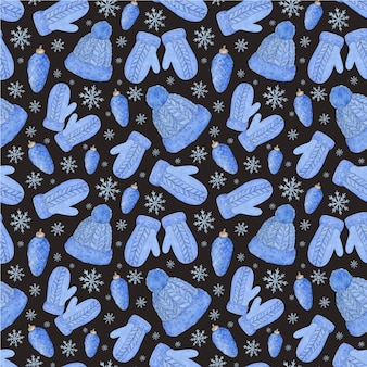 Watercolor seamless pattern with mittens, hats, cones and snowflakes.blue knitted winter clothing