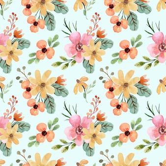 黄色とオレンジ色の春の花と水彩のシームレスなパターン
