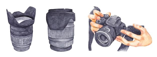 Акварельный набор фотоаппарата в руках объектива для фотографирования