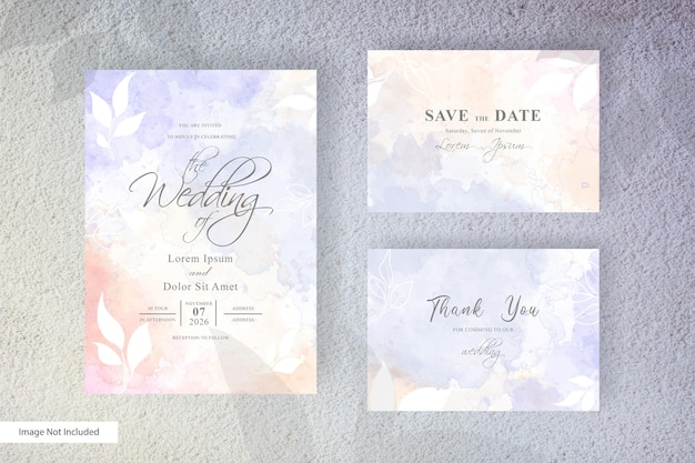 Watercolor wedding invitation template with simple floral and hand painted liquid watercolor