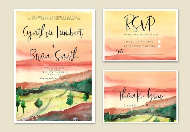 夕焼け空と芝生のフィールドと水彩の結婚式の招待状