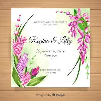 Watercolor wedding invitation with tropical flowers