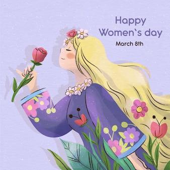 Donna dell'acquerello che sente l'odore di un fiore