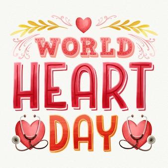 Iscrizione di giornata mondiale del cuore dell'acquerello con cuore e stetoscopi