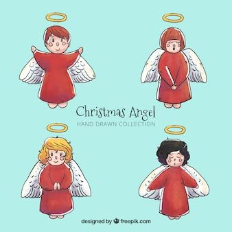 Акварельные рождественские ангелы в красных одеждах