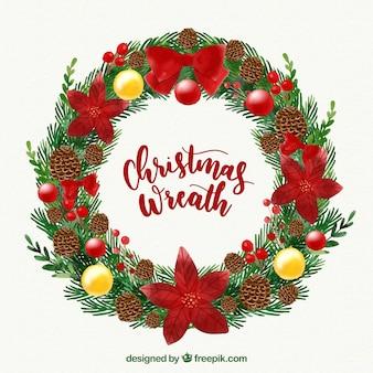 Акварельный рождественский венок с красными украшениями