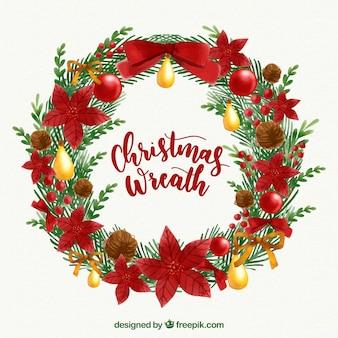 Акварельный рождественский венок с красными цветами и золотыми украшениями
