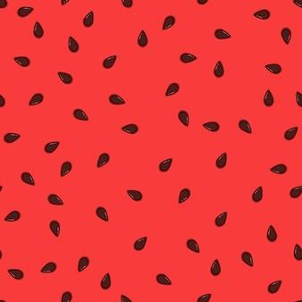 スイカの種の背景。黒い粒のジューシーで甘い果肉のスイカのパターン