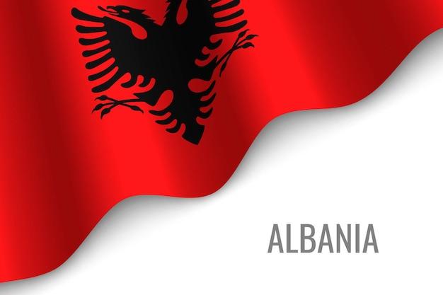 알바니아의 깃발을 흔들며