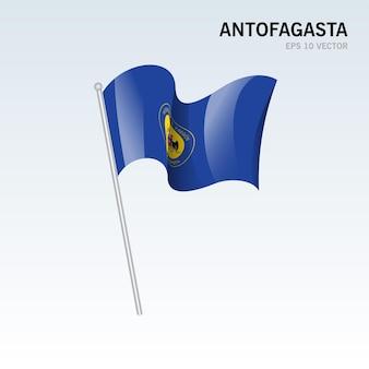 灰色の背景に分離されたチリのアントファガスタ地域の旗を振る