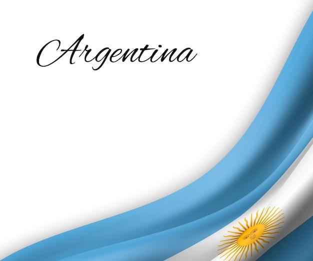 白い背景の上のアルゼンチンの旗を振っています。
