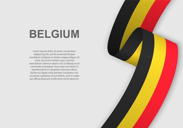 벨기에의 깃발을 흔들며.