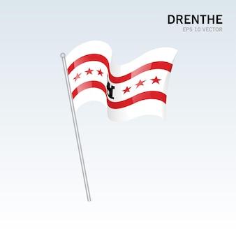 회색 배경에 고립 된 네덜란드의 drenthe 지방의 깃발을 흔들며