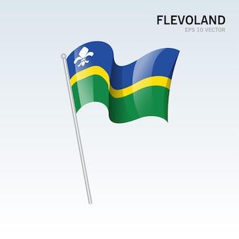 회색 배경에 고립 된 네덜란드의 Flevoland 지방의 깃발을 흔들며 프리미엄 벡터