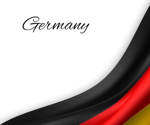 白い背景の上のドイツの旗を振っています。
