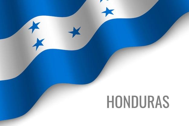 온두라스의 깃발을 흔들며.