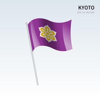 灰色の背景に分離された日本の京都府の手を振る旗