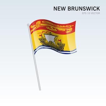 灰色の背景に分離されたカナダのニューブランズウィック州の旗を振る