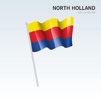 회색 배경에 고립 된 네덜란드의 북부 네덜란드 지방의 깃발을 흔들며