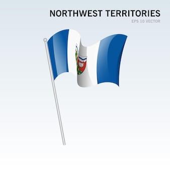 회색 배경에 고립 된 캐나다의 노스웨스트 준주 지방의 깃발을 흔들며