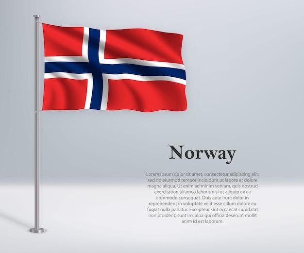 깃대에 노르웨이의 깃발을 흔들며
