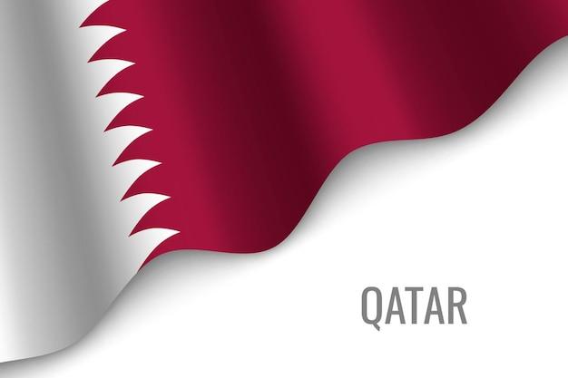 カタールの旗を振る