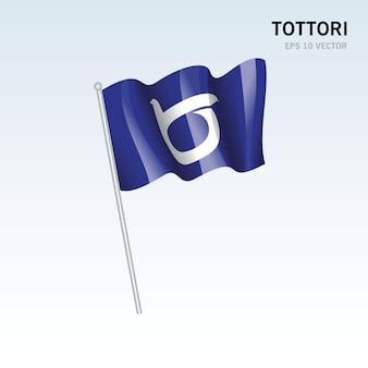 회색 배경에 고립 된 일본 돗토리 현의 깃발을 흔들며
