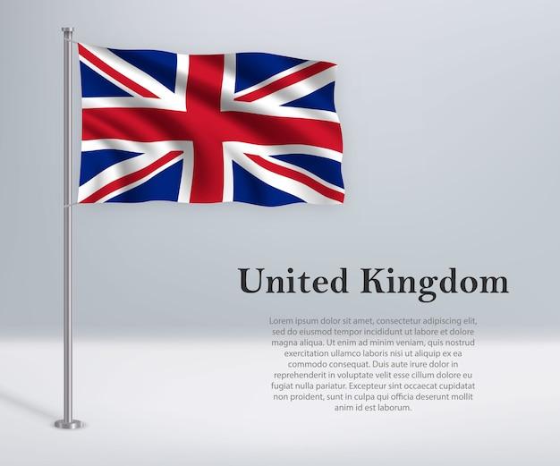 旗竿にイギリスの旗を振る