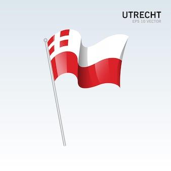 회색 배경에 고립 된 네덜란드의 위트레흐트 지방의 깃발을 흔들며