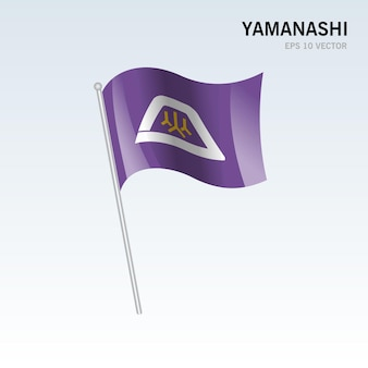 회색 배경에 고립 된 일본 야마나시 현의 깃발을 흔들며