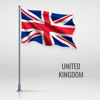 Развевающийся флаг на флагштоке.