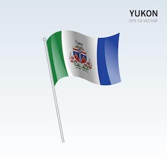 Waving flag of yukon provinces of canada isolated on gray background