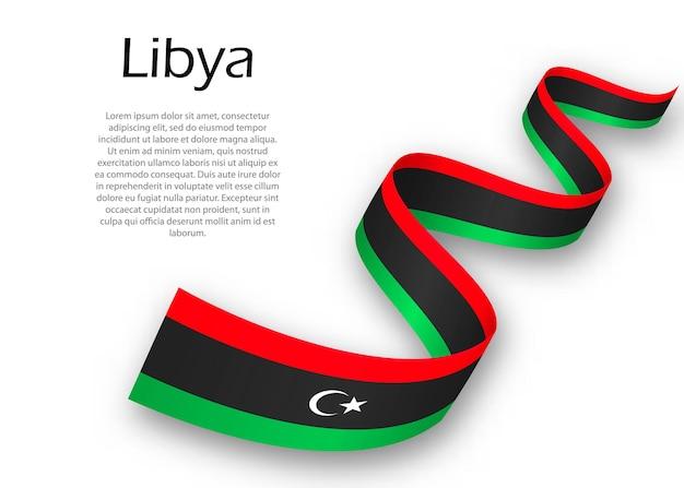 Размахивая лентой или знаменем с флагом ливии. шаблон для дизайна плаката ко дню независимости