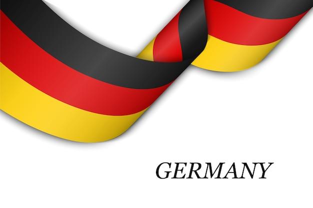 Размахивая лентой с флагом германии.