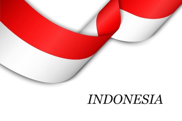 インドネシアの旗とリボンを振っています。