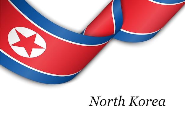 북한의 국기와 함께 리본을 흔들며.