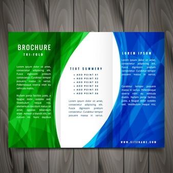 파란색과 녹색 색상의 물결 모양의 추상 삼중