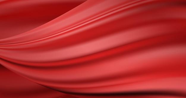 波状の豪華な赤の流れるサテンの背景。緋色のシルク生地の質感