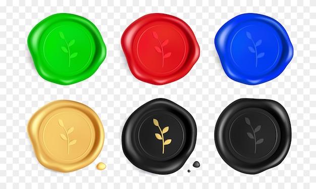 枝付きワックスシールセット。緑、赤、青、金、黒のワックスシールスタンプと枝が分離されています。リアルな保証スタンプ。