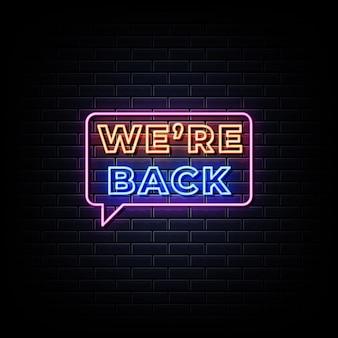 We are back neon sign on black wall