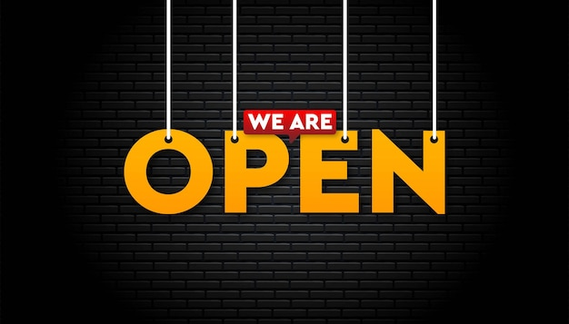 We are open banner on black brick wall