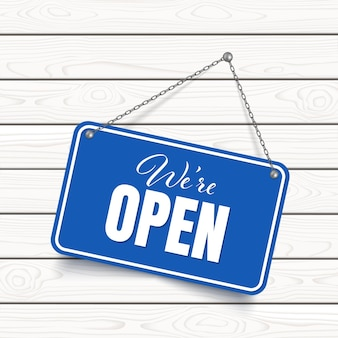 We are open blue sign isolated on wooden background