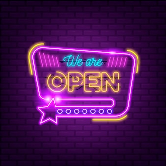 'we are open' neon sign