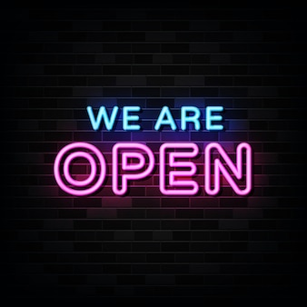 We are open neon signs on black wall