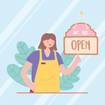 We are open sign and young employee with apron