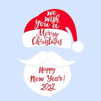 Мы желаем вам счастливого рождества и счастливого нового года рука надписи санта-клаус шляпа борода и усы
