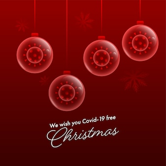 We wish you christmas message text with coronavirus inside transparent baubles hang on dark red background.